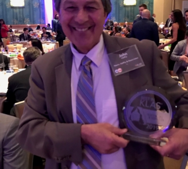 John Haffty receiving the 2019 Best in KLAS award for Technical Services at HIMSS 2019